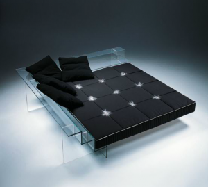 black bedding on a glass bed
