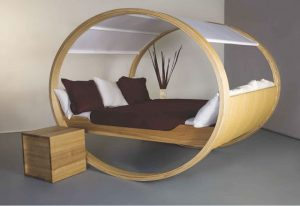 rocking chair style bed made out of wood