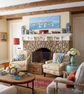 living room tan cobblestone beach theme fireplace
