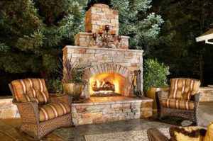 brown tone brick wood burning fireplace