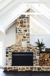 multi tone browns stone fireplace with wood storage
