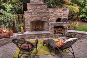 fireplace with pizza oven and fire wood storage
