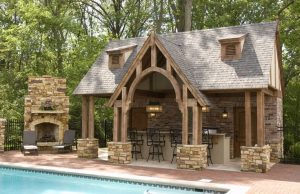 outside pool stone fireplace