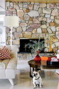 yellow, red, white, and brown stone fireplace