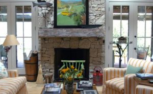 gray stone and wood mantel living room fireplace
