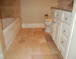 remodeled bathroom tile white cabinets