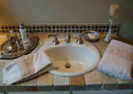 remodeled bathroom sink with tile countertop