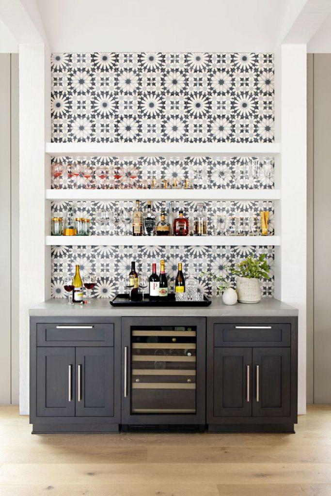 Mediterranean tiles behind home bat with dark wood