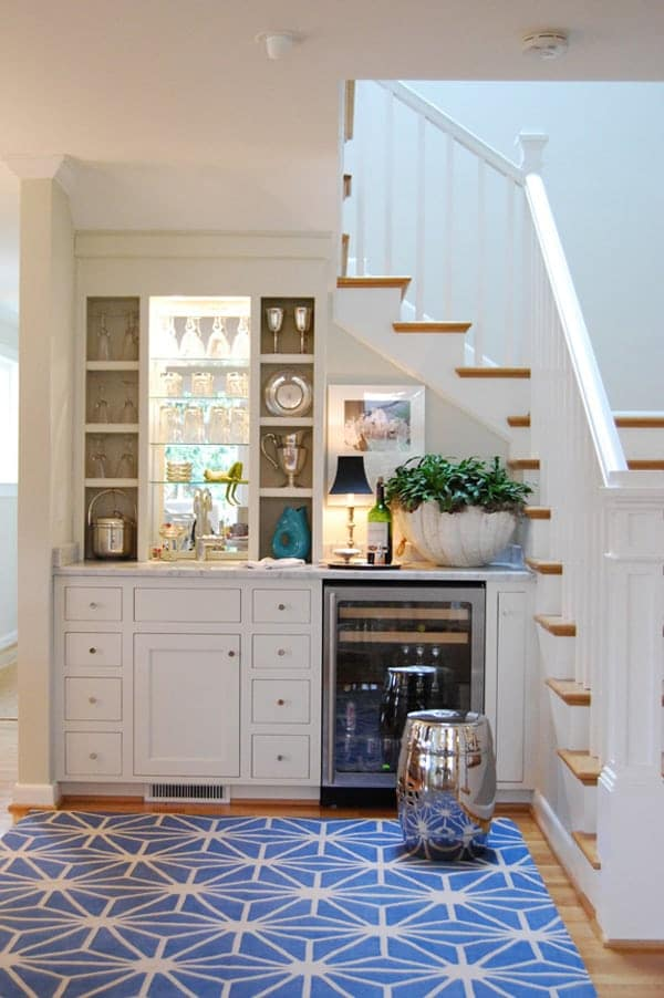 white home bar under the stairs