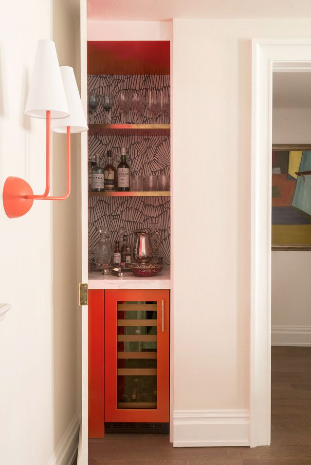 small red home bar design in a closet