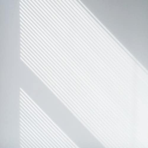 white wall with diagonal white light lines
