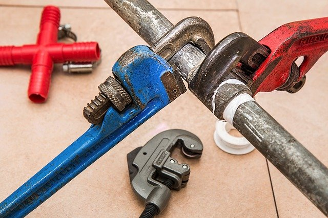 wrenches on a pipe home maintenance