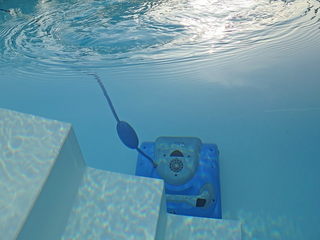 cleaning robot on bottom of swimming pool