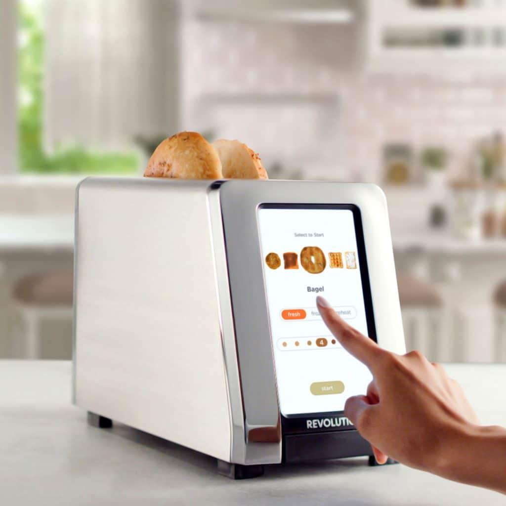 touchscreen smart toaster in a kitchen with a bagel in it