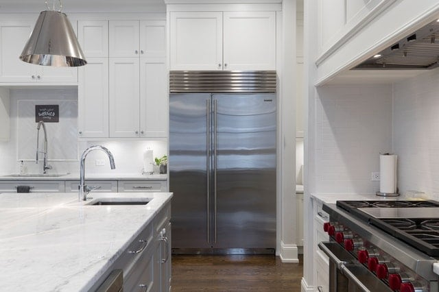kitchen with stainless steel appliances - refrigerator, dishwasher, and stove