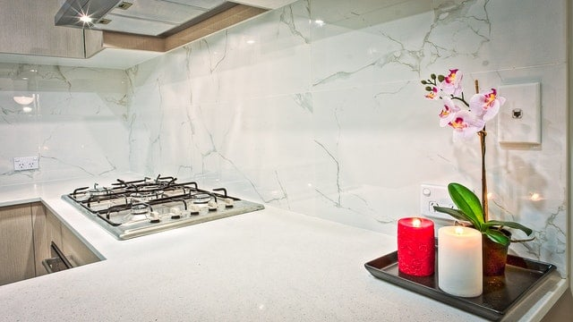 modern kitchen marble backsplash white and grey over stainless steel stovetop