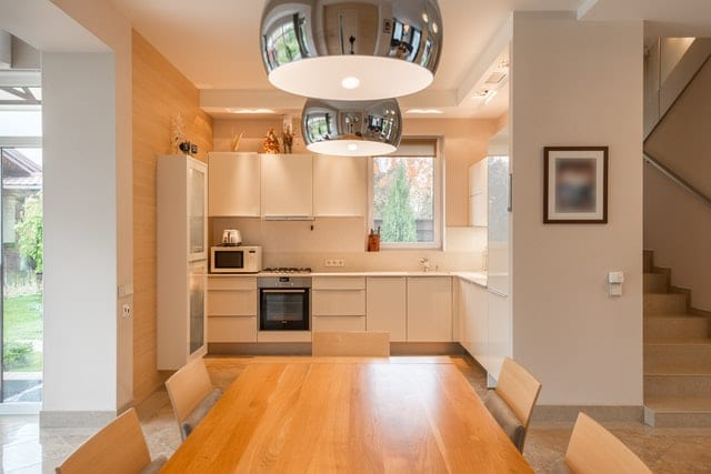 kitchen remodel renovation modern simple kitchen with light wood details and stainless steel lighting